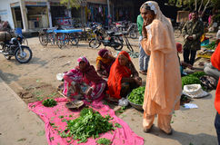 Jodhpur, India - January 2, 2015: Indian people shopping at typical vegetable street market Stock Image