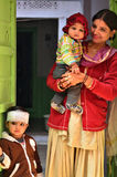 Jodhpur, India - January 1, 2015: Indian proud mother poses with her children in Jodhpur Royalty Free Stock Images