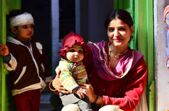 Jodhpur, India - January 1, 2015: Indian proud mother poses with her children in Jodhpur. Royalty Free Stock Images