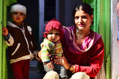 Jodhpur, India - January 1, 2015: Indian proud mother poses with Royalty Free Stock Photo