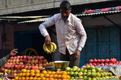 Jodhpur, India - January 1, 2015: Unidentified Indian man selling fruits at street market Stock Photo