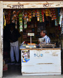 Jodhpur, India - January 1, 2015: Unidentified Indian man selling snack at market Royalty Free Stock Images