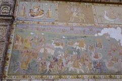 Wall paintings of ancient temple royalty free stock image