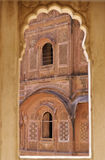 Jodhpur palace. Through a mogul style window a full carved front of an inner courtyard of giant palace of Meherangarh Fort in Jodhpur, Rajasthan, India Royalty Free Stock Photos