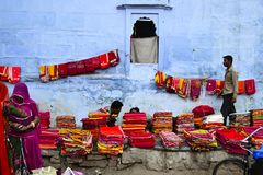 People selling sarees, colorful tissues. Jodhpur, Rajasthan, India - December, 2016: People selling sarees, colorful tissues and other fabric tissues and other royalty free stock photo