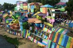 Jodipan añade color a Malang foto de archivo