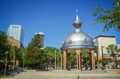 Joe Chillura Courthouse Square, metallic dome, Tampa, Florida. People walking through Joe Chillura Courthouse Square, metallic dome, Tampa, Florida, United Royalty Free Stock Photography
