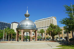 Joe Chillura Courthouse Square, metallic dome, Tampa, Florida. People walking through Joe Chillura Courthouse Square, metallic dome, Tampa, Florida, United Royalty Free Stock Images