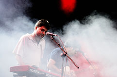 Joe Crepusculo playing the keyboard surrounded by smoke performs at FIB Royalty Free Stock Photos