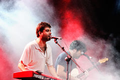 Joe Crepusculo playing the keyboard surrounded by smoke performs at FIB Stock Photography