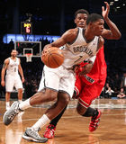 Joe Johnson, Jimmy Butler. BROOKLYN, NY-APR 22: Brooklyn Nets shooting guard Joe Johnson dribbles past Chicago Bulls shooting guard Jimmy Butler at Barclays stock photos