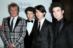 Joe Jonas, Kevin Jonas, Nick Jonas, Rod Stewart Royalty Free Stock Photography