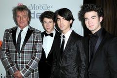 Joe Jonas, Kevin Jonas, Nick Jonas, Rod Stewart Fotografia Stock Libera da Diritti