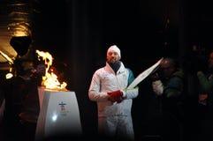 Joe Juneau allume la flamme olympique Photo libre de droits