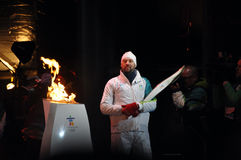 Joe Juneau lights Olympic Flame Royalty Free Stock Photo