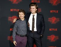 Joe Keery and Gaten Matarazzo. At the Netflix`s season 2 premiere of `Stranger Things` held at the Regency Village Theatre in Westwood, USA on October 26, 2017 Stock Photography