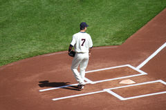 Joe Mauer at home plate. Joe Mauer, catcher for the Minnesota Twin, catches the ceremonial opening pitch from his father on Saturday, April 17, 2010 at the game Stock Photography