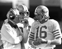 Joe Montana en Bill Walsh stock foto