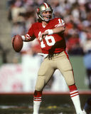 Joe Montana Quarterback of the San Francisco 49ers. Sitting the pocket getting ready to pass the Football Stock Images