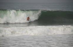 Joel Parkinson riding a wave stock images