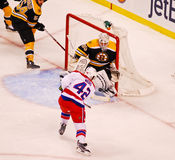 Joel Ward puts a shot on Tim Thomas (NHL Hockey) Royalty Free Stock Images
