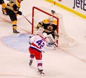 Joel Ward puts a shot on Tim Thomas (NHL Hockey) Royalty Free Stock Images