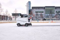 Ice resurfacer to clean and smooth the surface of a sheet of ice rink royalty free stock images