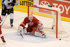 Joey MacDonald Eyes The Puck. Joey MacDonald of the Detroit Red Wings searches for the puck during a game against the San Jose Sharks at Joe Louis Arena during Stock Photo
