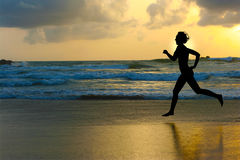 Jog. One woman running during sunset Royalty Free Stock Photography