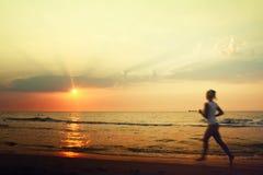 Jog on the beach. Girl commits jog on the beach Stock Images