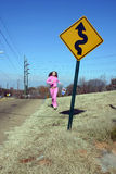 Jog down the winding road Royalty Free Stock Photography