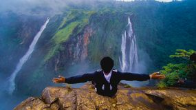 Jog falls . guy enjoying the beautiful nature view stock photo