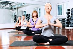 Joga. Group of young women in the gym centre. Yoga Stock Image