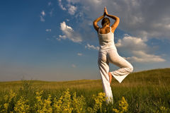 Joga. Beautiful woman relax in the nature Stock Photography