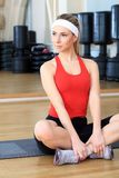 Joga pose. Young sporty woman in the gym centre royalty free stock images
