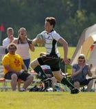 Jogador da velocidade da corrida da bola de rugby Fotos de Stock