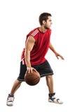 Jogador de basquetebol com a bola isolada no branco Imagens de Stock Royalty Free