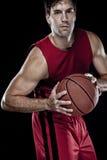 Jogador de basquetebol com uma esfera Imagens de Stock Royalty Free