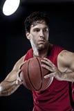 Jogador de basquetebol com uma esfera Fotos de Stock