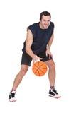 Jogador de basquetebol profissional com bola Fotografia de Stock Royalty Free