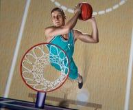 Jogador de basquetebol que faz o afundanço na arena do basquetebol Imagens de Stock Royalty Free