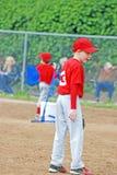 Jogador de beisebol da liga júnior. imagens de stock royalty free