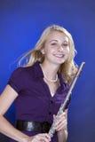 Jogador de flauta adolescente isolado no azul Fotos de Stock Royalty Free