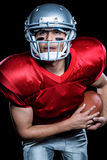 Jogador de futebol americano com bola Foto de Stock Royalty Free