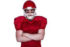 Jogador de futebol americano com os braços cruzados Fotografia de Stock Royalty Free