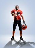 Jogador de futebol americano no branco da ação isolado Imagens de Stock Royalty Free