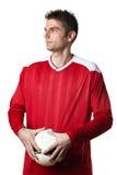 Jogador de futebol com esfera Imagem de Stock