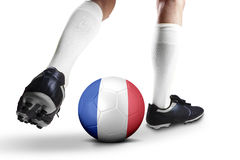 Jogador de futebol das FO dos pés que joga uma bola Fotos de Stock Royalty Free