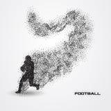 Jogador de futebol de uma silhueta da partícula Imagens de Stock