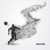 Jogador de futebol do futebol de uma silhueta da partícula Foto de Stock Royalty Free